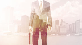 Businessman standing at cityscape background Royalty Free Stock Photography
