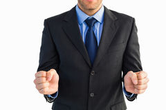 Businessman standing clenching his fists Royalty Free Stock Image