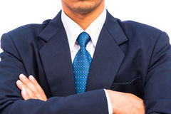 Businessman standing with closed posture Stock Photo