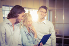 Businessman standing with colleagues Royalty Free Stock Photos