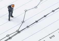 Businessman standing on the compare graph Royalty Free Stock Photography