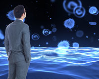 Businessman standing. Composite image of businessman standing royalty free stock photography