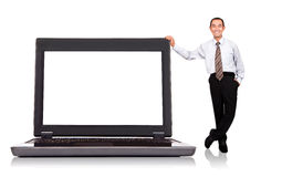 Businessman standing by  computer Stock Images