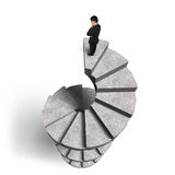 Businessman standing on concrete spiral staircase Royalty Free Stock Photography