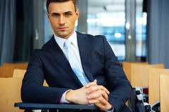 Businessman standing at conference hall Stock Photos