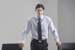 Businessman Standing In Conference Room Royalty Free Stock Photo
