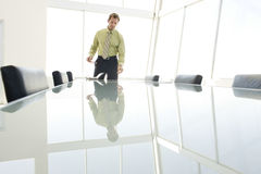 Businessman Standing At Conference Table Royalty Free Stock Images