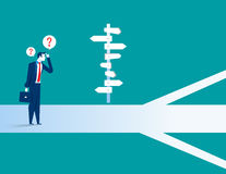 Businessman standing confused by direction sign. Concept business illustration. Vector flat Royalty Free Stock Images