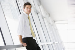 Businessman standing in corridor Royalty Free Stock Photo