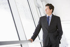 Businessman standing in corridor Royalty Free Stock Photography