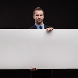 Businessman standing on dark background Royalty Free Stock Photo