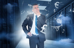 Businessman standing in data center with currency graphics Royalty Free Stock Image