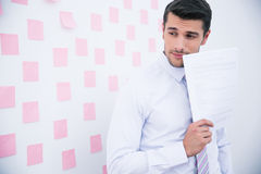 Businessman standing with document Royalty Free Stock Photography