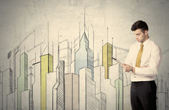 Businessman standing with drawn cityscape Royalty Free Stock Photo