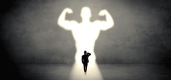 Businessman standing in front of a strong hero vision stock images