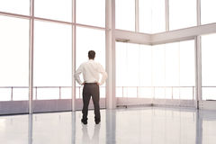 Businessman standing in an empty room Stock Photos
