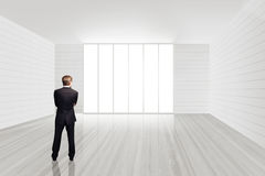 Businessman standing in an empty room Stock Image