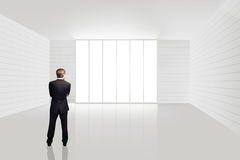 Businessman standing in an empty room Stock Images