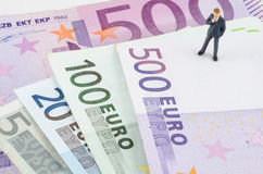 Businessman standing on the Euro banknote Royalty Free Stock Photography