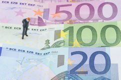 Businessman standing on the Euro banknote Royalty Free Stock Image