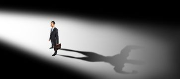 Businessman standing face to the light stock photography