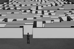 Businessman standing and facing huge maze structure Royalty Free Stock Photos