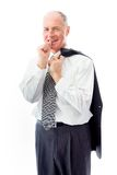 Businessman standing with finger in mouth Stock Images