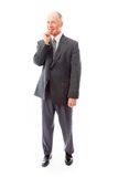 Businessman standing with finger in mouth Stock Photo