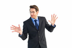 Businessman standing with fingers spread out Stock Photography