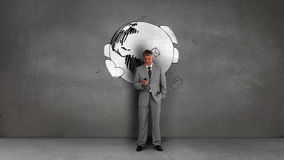 Businessman standing in front of animated envelopes circling earth Stock Photo