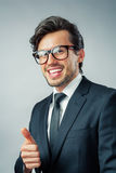 Businessman showing thumb up Stock Image