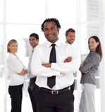 businessman standing in front of co-workers Royalty Free Stock Photography