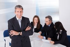 Businessman Standing In Front Of Colleagues Royalty Free Stock Photo