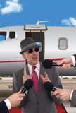 Businessman standing in front of corporate jet Stock Image