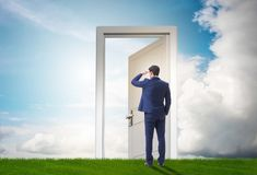 Businessman standing in front of door into future royalty free stock photos