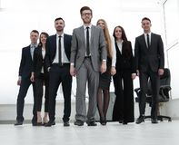Businessman standing in front of her business team Royalty Free Stock Photography