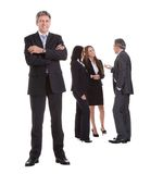Businessman standing in front of his colleagues stock photography