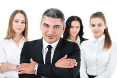Businessman standing in front of his colleagues Stock Image