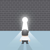 Businessman standing in front of keyhole Stock Images
