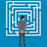 Businessman standing in front of a maze with a solution to succe. Ss,stock vector illustration Royalty Free Stock Photos