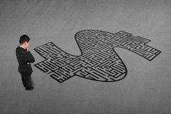 Businessman standing in front of money shape maze Stock Photography