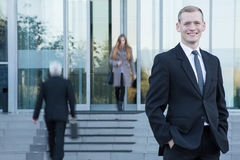 Businessman standing in front of office Stock Photo