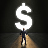 Businessman standing in front of a portal shaped as a dollar-symbol Royalty Free Stock Photography