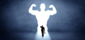 Businessman standing in front of a strong hero vision stock illustration