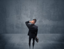 Businessman standing in front of urban wall Royalty Free Stock Photo