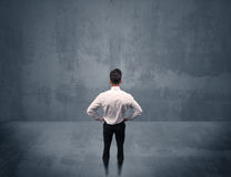 Businessman standing in front of urban wall Royalty Free Stock Photography