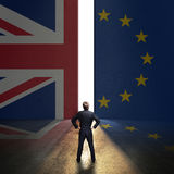Businessman standing in front of a wall with the union jack and the eu flag. And a portal Royalty Free Stock Images