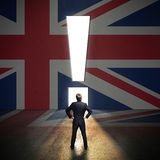 Businessman standing in front of a wall with the union jack Royalty Free Stock Images