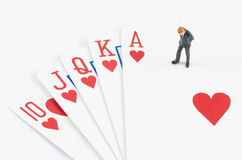 Businessman standing on the gamble card Stock Photography