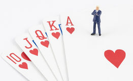 Businessman standing on the gamble card Stock Photos